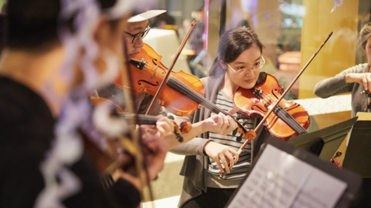 People playing music, violin.