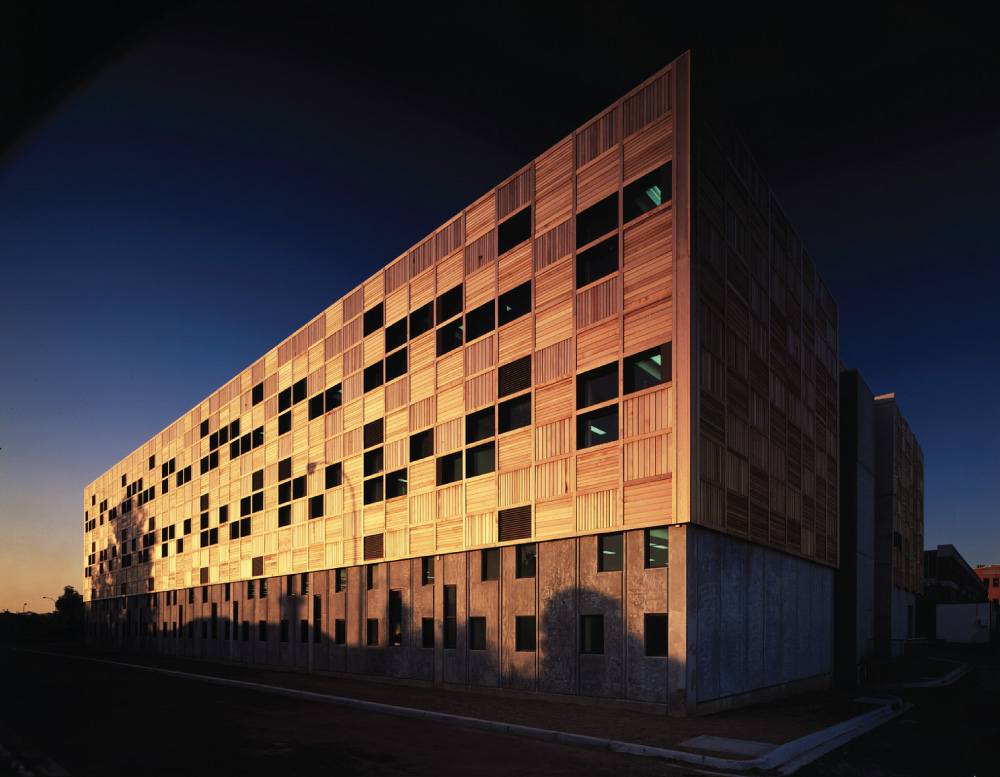An RMIT building lit up by the sun at sunset